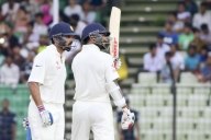 Dhawan-Vijay put India on top on rain-marred day