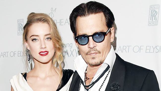 Depp's wife summoned for smuggling dogs into Australia
