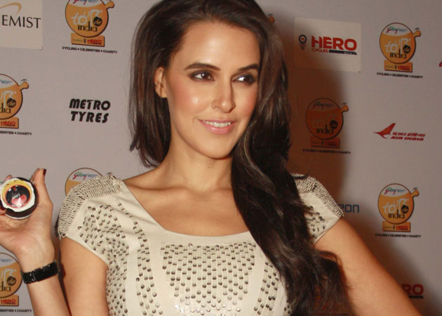 Don't have patience to be on fiction TV: Neha Dhupia