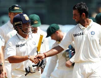 Sachin Tendulkar of India  and Cheteshwar Pujara of India  shake hands after the win during day 5 of the 1st Airtel Test match between India and Australia at the M. A. Chidambaram Stadium in Chennai on the 26th February 2013  Photo by Ron Gaunt/BCCI//SPORTZPICS  Use of this image is subject to the terms and conditions as outlined by the BCCI. These terms can be found by following this link:  http://www.sportzpics.co.za/image/I0000SoRagM2cIEc