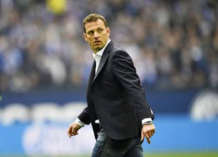 FILE - In this April 1, 2017 file photo Schalke's head coach Markus Weinzierl looks back after the German Bundesliga soccer match between FC Schalke 04 and Borussia Dortmund in Gelsenkirchen, Germany. Weinzierl was sent off the field of play. (AP Photo/Martin Meissner, file)