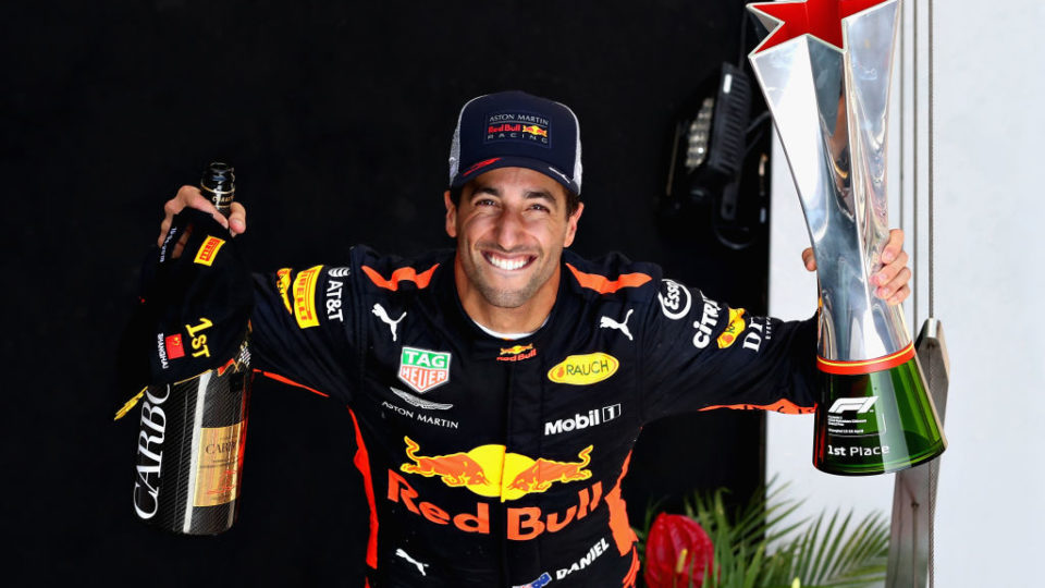 SHANGHAI, CHINA - APRIL 15:  Race winner Daniel Ricciardo of Australia and Red Bull Racing celebrates on the podium during the Formula One Grand Prix of China at Shanghai International Circuit on April 15, 2018 in Shanghai, China.  (Photo by Mark Thompson/Getty Images)